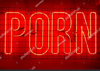 stock-photo-porn-red-neon-sign-fixed-to-a-wall-behind-metal-cage-1042116907